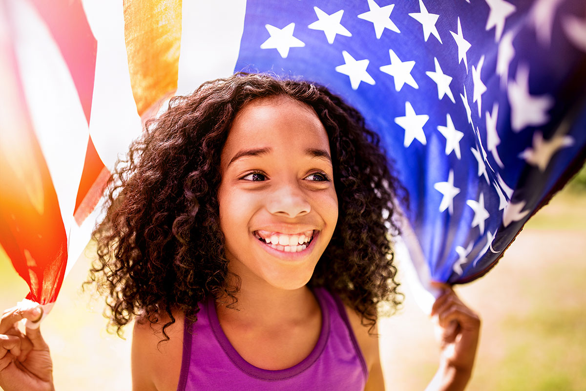 Young girl with an American flag